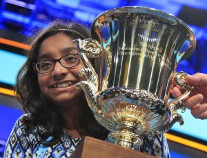 Ananya Vinay, a 12-year-old from Fresno, California, holds the trophy after being declared the winner of the 90th Scripps National Spelling Bee, in Oxon Hill, Maryland, on Thursday. (Manuel Balce Ceneta/AP)