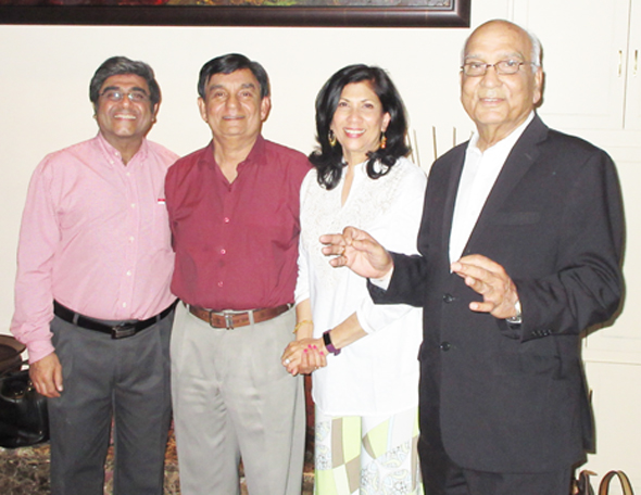 Rao and his wife Sheila hosted the CC quarterly meeting at their house. A CC founder, Atul Vir (left) stood by as Surinder Talwar (right) regaled the couple with two lines of a popular Hindi song.