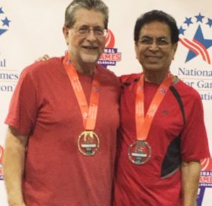 Dilip Desai (right) with partner Don Weems after winning the silver medal for National Seniors table tennis doubles tournament.