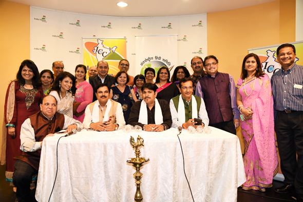 The boards of the International Hindi Association Houston Chapter and the India Culture Center posed with the three poets and IHA president Swapan Dhairyawan (back row, center).