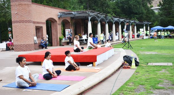 The yoga instructors gave direction on the asanas to the 450 people who came to the event