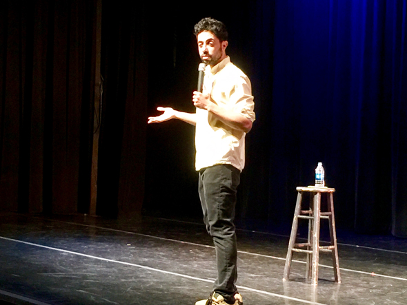 Commedian Sammy Obeid presented his act with bare essentials -- a wooden stool that he did not use and the first of three water bottles that he consumed.