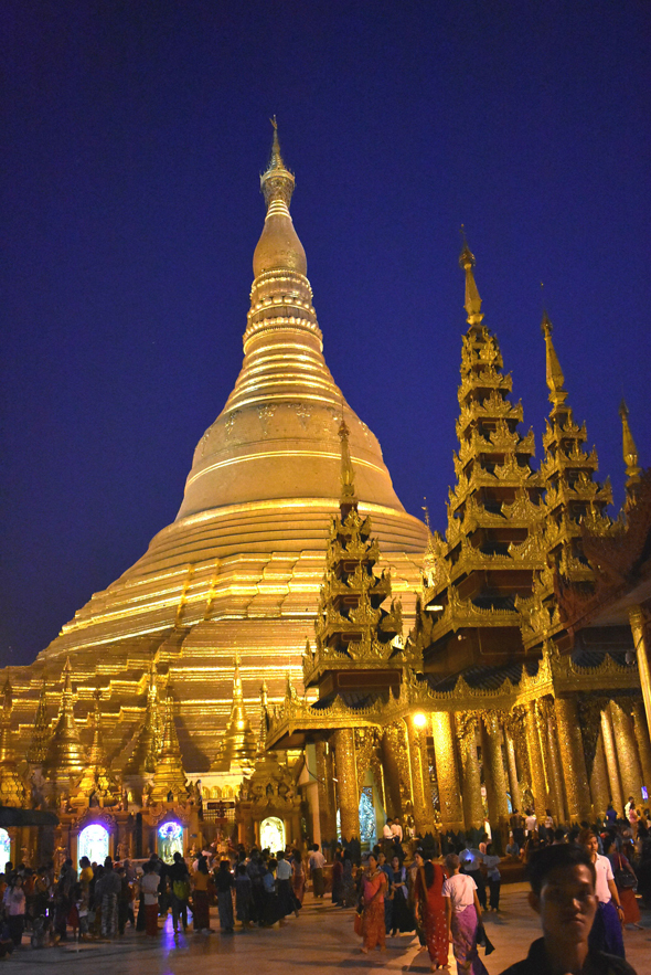 The gilded Shwedagon Pagoda is lit up at night and can be seen from anywhere in the city