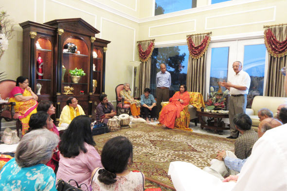 Before her speech in Umesh Jain's house, Didi Maa listened to her ardent supporter Brahm Ratan Agarwal (standing on right) describe his experience at the Vatsalaya Gram in Vrindavan