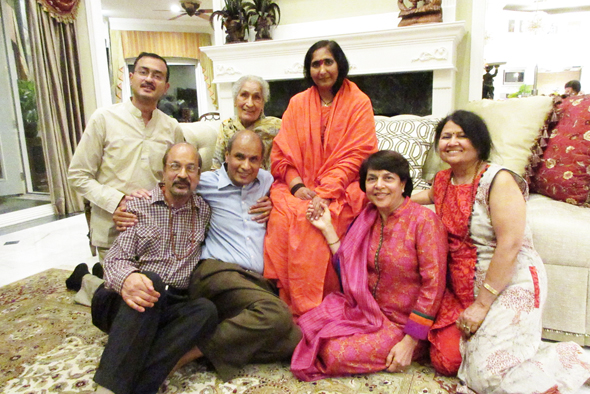 Didi Maa surrounded by the Jain family. From left, Nishant, Ravinder, Umehsh, Didi Maa, Rajni and Kamini