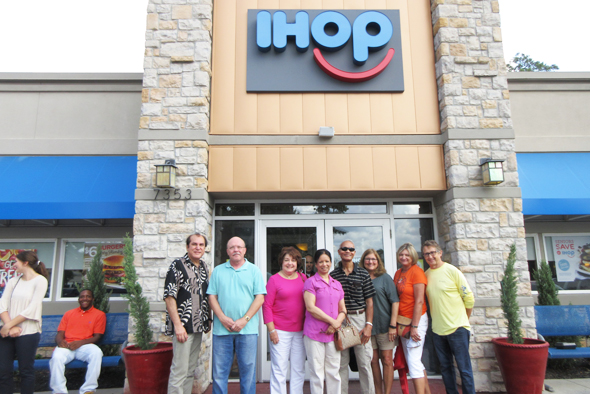 Datta-Barua (in sunshades) next to his wife and with his supporters at the IHOP in Kingwood.