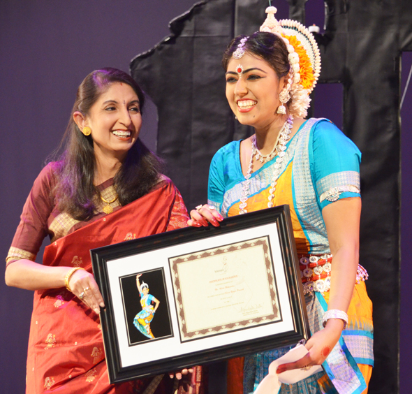 Meha Mohapatra after her Odissi debut performance with her guru Supradipta Datta who handed her the certificate of completion.