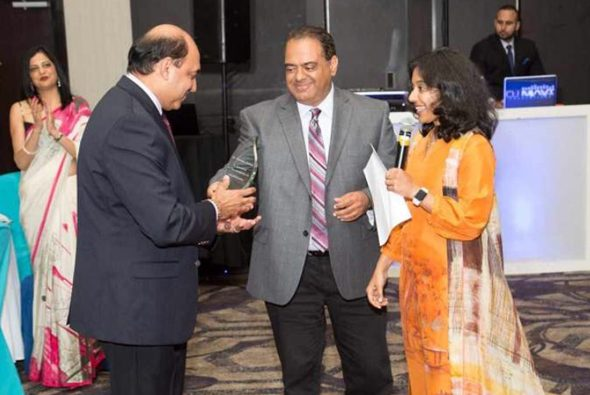 Dr. Randeep Suneja receiving a Special Honor Award from Dr. Tony Sharma and President Dr. Tarang Sharma.