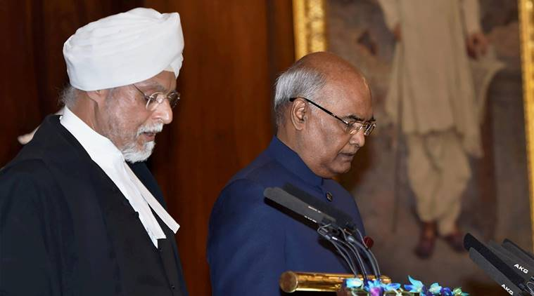 Chief Justice of India, Justice JS Khehar administers oath of office to Ram Nath Kovind as the 14th President of India at a special ceremony in the Central Hall of Parliament in New Delhi on Tuesday. (PTI Photo by Shahbaz Khan)