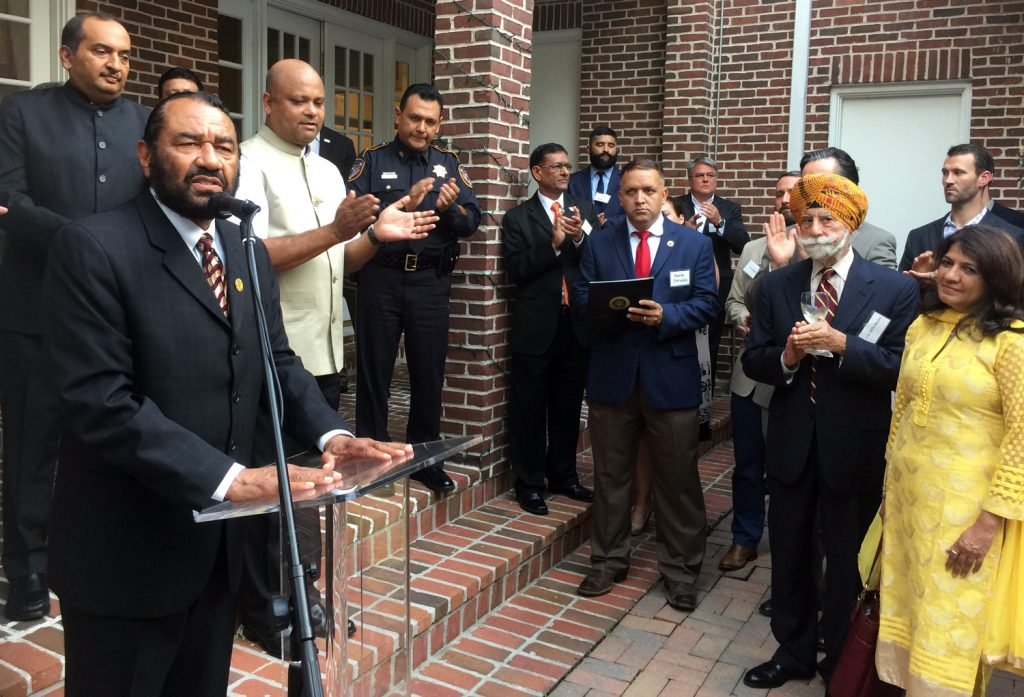 Congressman Al Green (at lectern) presented a Congressional Proclamation recognizing India's Independence Day as dignitaries Jiten Agrawal (left), Consul General Anupam Ray, Harris County Sheriff Ed Gonzales applaud with Congressional aides with Col. Raj Bhalla and TV Asia's Manisha Gandhi.
