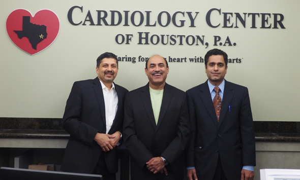 Dr. Randeep Suneja (center) flanked by his partners Dr. Ram Pai (left) and Dr. Kamal Desikan at their practice in Katy.