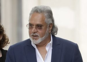 Former Indian politician and billionaire businessman Vijay Mallya, centre, arrives for his extradition hearing arrives at Westminster Magistrates Court in London, Tuesday, June 13, 2017. Mallya was arrested in London in April on behalf of authorities in India, where he is wanted on charges of money laundering and bank demands that he pay back more than a billion dollars in loans extended to his now-defunct airline. (AP Photo/Matt Dunham)