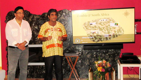 Connoisseurs Club co-founder Atul Vir introduces the topic – a tour of South Africa and Zambia - that Santosh Desai (left) was going to present.