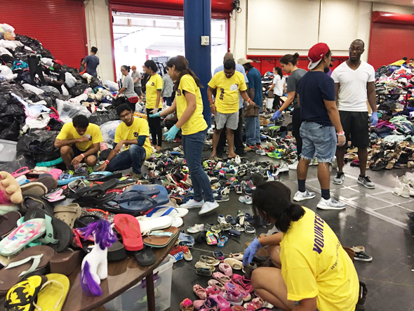 Sewa Volunteers help sort the donations.