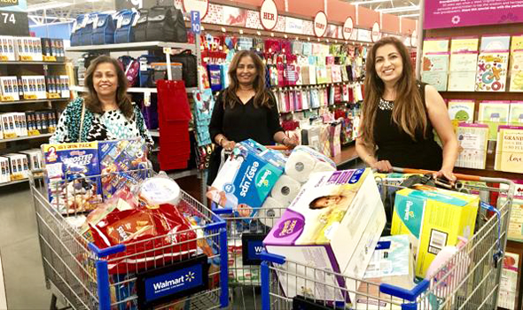 Drs. Anjana Samadder (left) and Udaya Shivangi and Manju Sachdev (right) shopping for supplies at Walmart