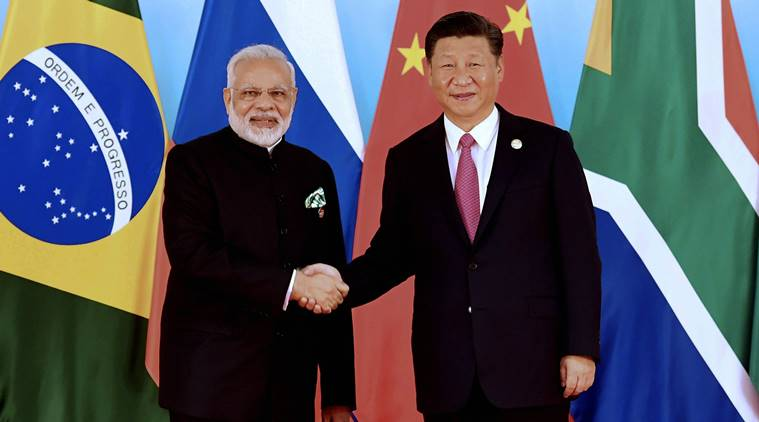Xiamen : In this photo released by Xinhua News Agency, Chinese President Xi Jinping, right, shakes hands with Indian Prime Minister Narendra Modi at the BRICS Summit in Xiamen in southeastern China's Fujian Province, Monday, Sept. 4, 2017. AP/PTI(AP9_4_2017_000159B)