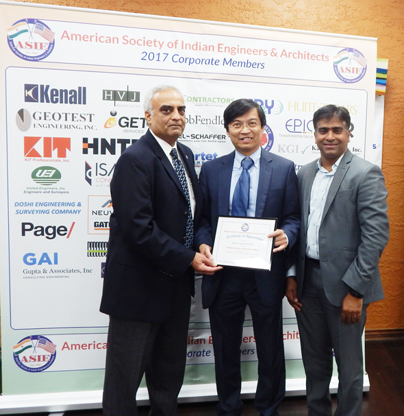 Certificate of Appreciation presented to Dr. Daniel Wong (center) by ASIE VP Chetan Vyas on left and Naresh Kolli past president of ASIE on right.