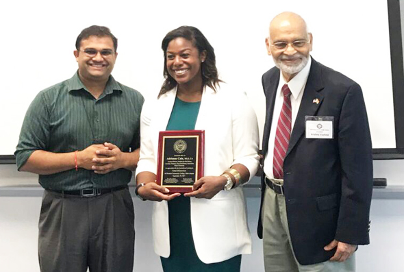 Ravi Brahmbhatt (left), Director of Student Innovation & Entrepreneurship and Adjunct Faculty in HCC; Adrienne Cain, Assistant Director of the Institute for Oral History and Secretary-Treasurer of Texas Oral History Association with Baylor University in Waco, holding a momento presented by Krishna Vavilala, FIS Founder-Chairman.