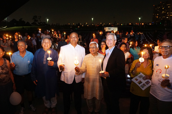 The finale of the evening celebrating Mahatma Gandhi's 148th birthday as 1000 Lights For Peace at the Miller Outdoor Theatre was candle lighting by all present, as pledge to practice peace in their lives. It was initiated by Consul General of India, Dr. Anupam Ray.