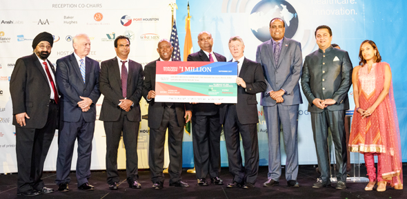 "A symbolic check from the Indian American Community ""Marching Towards a Million"" acknowledging and celebrating the contributions that have already been made was presented to Harris County Judge Ed Emmett and Houston Mayor Sylvester Turner by Consul General Dr. Anupam Ray, Sapphira Goradia, Jagdip Ahluwalia, Allen Richards, Amit Bhandari of BioUrja, Harish Shanbhag of Wipro and Mani Iyer of Mahindra USA."