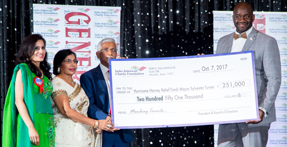 Houston Vice Mayor Pro Tem Jerry V. Davis (District B) accepts a replica of the $251,000 check from Guests of Honor and chief benefactor Swatantra Jain and his wife Bimla. IACF President Vanitha Pothuri is on the extreme left, during the IACF Gala on Saturday, October 7 at the Stafford Centre. Photos: Roy Photography