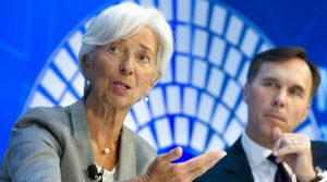 International Monetary Fund (IMF) Managing Director Christine Lagarde accompanied by Canada Finance Minister William Morneau, speaks during a Global Economy debate in the sidelines of the World Bank/IMF Annual Meetings in Washington, Thursday, Oct. 12, 2017. ( AP Photo/Jose Luis Magana)