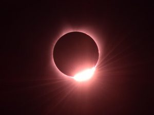"""Picture on right: In August, Anil took this """"diamond ring"""" image of the solar eclipse."""