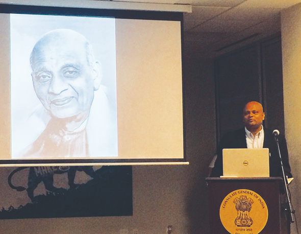 Speaking in front of Sardar Vallabhbhai Patel's screen image was CG Dr. Anupam Ray. Dr. Ray praised Sardar Patel for creating a united India and for his role in establishing the Indian Civil Servce.
