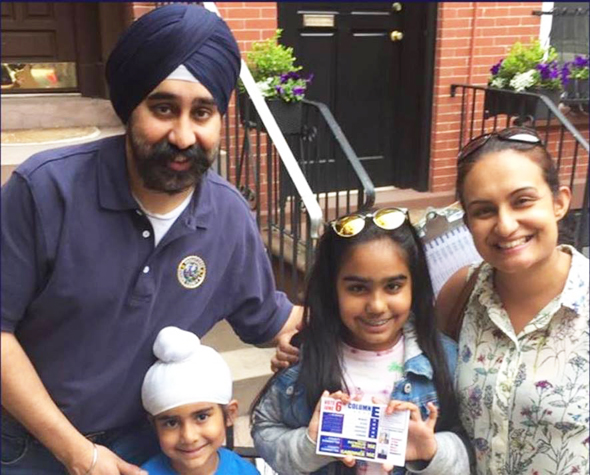 Ravinder Singh, Mayor-Elect of Edison, NJ with his wife Navneet and two kids