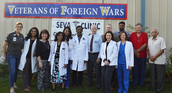 Mayor Reid of Pearland (center), Memorial Hermann leaders and Seva clinic team.