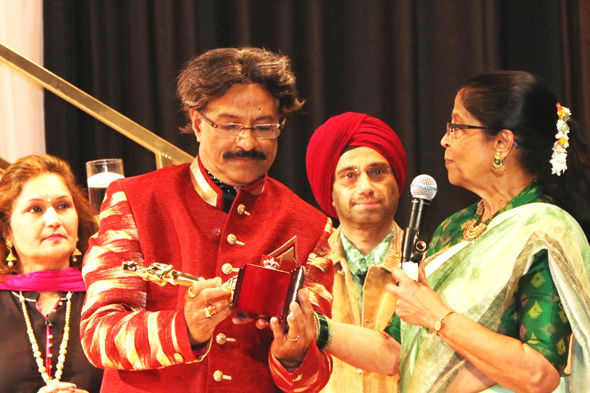 From left, Alpa Shah (co-director); Director Rajan Radhakrishnan, Subodh Bhuchar as the Sardar and Padmini Ranganathan, President of Udavum Karangal USA.