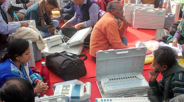 Lucknow: Polling officers collect electronic voting machines(EVM) and polling materials before leaving for polling booth on the eve of second phase voting of Uttar Pradesh Nagar Palika Election 2017 UP, in Lucknow on Saturday. PTI Photo  (PTI11_25_2017_000094a)