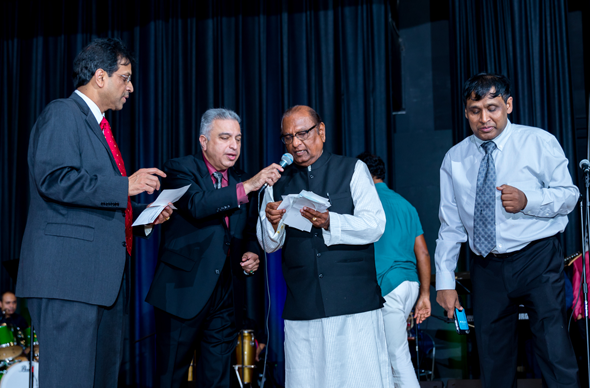 Reading out from the pledge cards are, from left, Dr. Ravi Chandru, Nozer Buchia, K.C. Mehta and Dr. Prasun Jalal