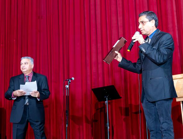 Program emcee Nozer Buchia (left) and auctioneer Subodh Bhuchar drummed up bids