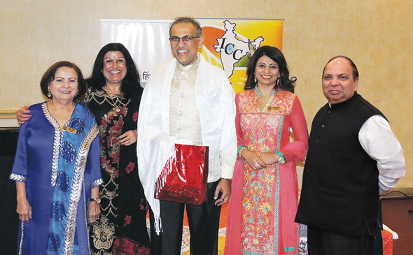Outgoing National International Hindi Association President Swapan Dhairyawan was presented with a token of appreciation and a white shawl by, from left, program emcee Meera Kapur, ICC President Falguni Gandhi, IHA Houston cofounder Sangeeta Pasrija and IHA President Dr. K.D. Upadhya.