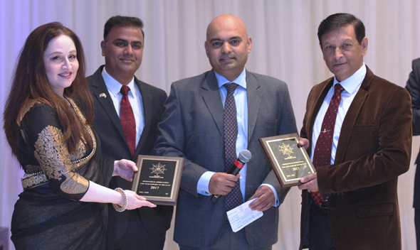 President Capt. Pradeep Talan (center right) and Capt. Janak Lotey, Secretary present awards of appreciation to Keka Kar (left) and her husband Capt. Jeet Kar. Photo: Solace Media, www.solace.media
