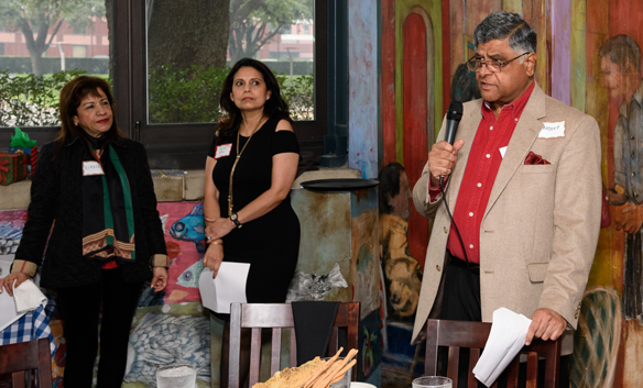 Club 24 Plus President Pradeep Gupta welcomes members and guests to the HoIday Brunch at Ciao Bello Italian restaurant as Kiran Gupta (far left) and Social Chair Savita Rao look on. Photos: Bijay Dixit