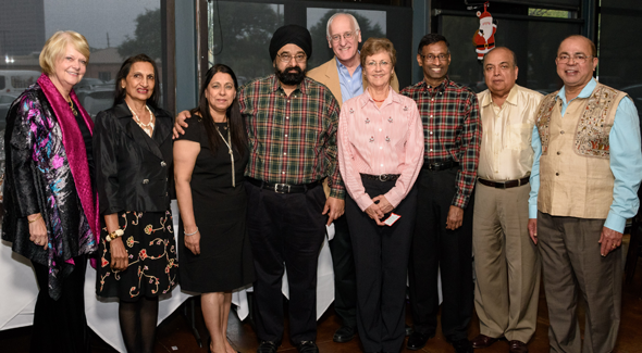 Group photo shows Mary Grace Landrum, Prabha Garg, Dammi and Jagdip Ahluwalia, Judge Michael Landrum, Elsie and Venu Rao, Ashok Garg and Sam Abraham.