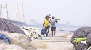 Fishermen return to their base at Worli Koliwada Monday. Nirmal Harindran