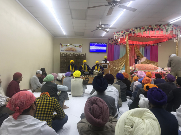 A continuous stream of the faithful who came throughout the day and night for the commemoration of the 351st birthday of the tenth Guru Gobind Singh at the Sikh National Center