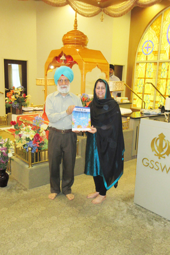 "Punjabi school Director Manmeet Likhari introduced Bhupinder Singh and his book ""Fish Eat Fish World"""