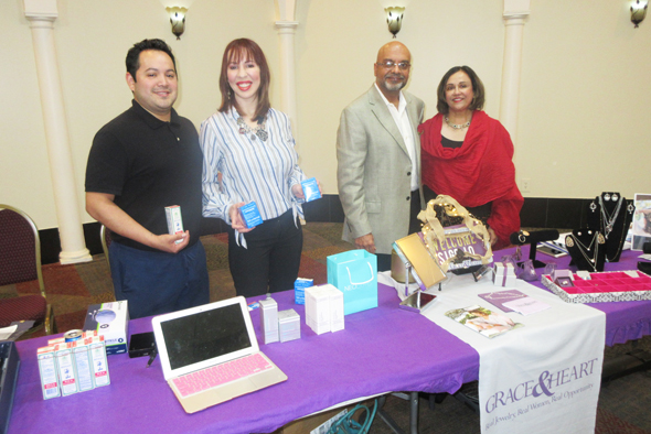 Vendors exhibited their products at the event. From left, Lawrence Torres and wife Sarai of Sylvan Beach Aesthetics and Dr. Abdul Moosa and wife Ashma Khanani-Moosa of Grace & Heart.