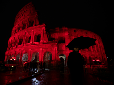 A view of the Colosseum lit up in red to draw attention to the persecution of Christians around the world. (AP)