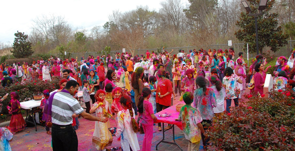 Hundreds playing with Holi colors spreading joy and cheer