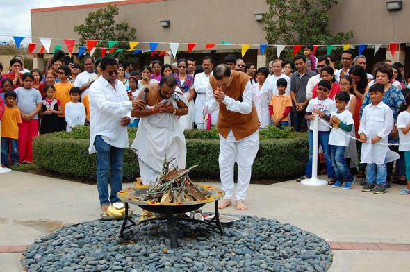 The priest,Sri Ganesh Satyanarayana and Acarya Gaurang Nanavaty doing puja, as they light the sacred Holi bonfire.