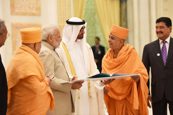 BAPS Swamis meet Indian Prime Minister Narendra Modi and Crown Prince of Abu Dhabi His Highness Sheikh Mohammed bin Zayed Al Nahyan and present an introductory book of plans for the upcoming Hindu Mandir in Abu Dhabi.
