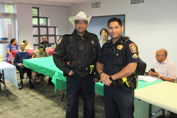 Deputy Sheriff Nasir Abbas (left) and Harris County Constable Pct. 5 Corporal Waqas Farahshah spoke to the Club 65 members at their meeting on Saturday, April 7.