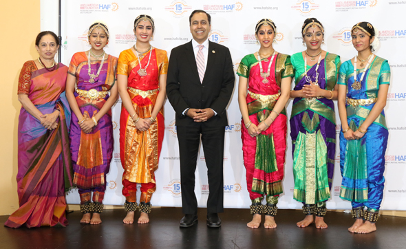 Padmini Chari (left) and performers from the Nritya School of Dance with Congressman Raja Krishnamoorthi (center) at HAF Gala.