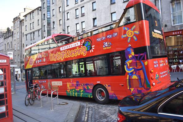 A colorful double-decker hop on-hop off tourist bus