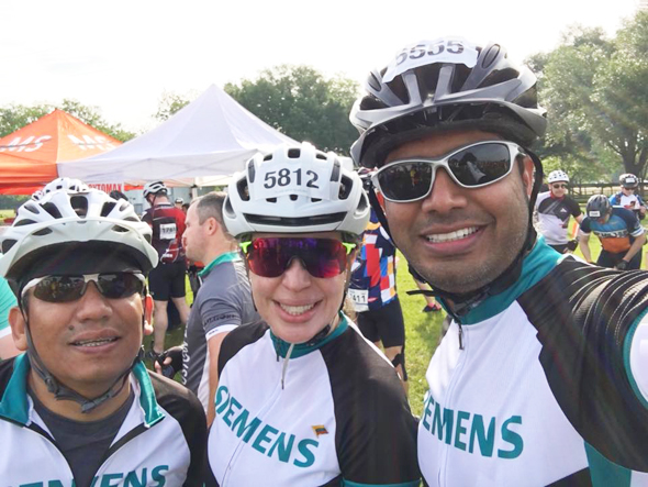Asam Syed (right) with his team mates from Siemens
